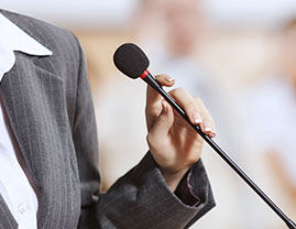 person speaking on a mic