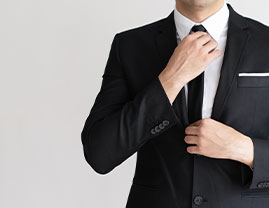 person poitioning his tie